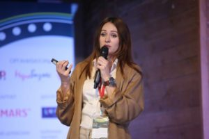 Anna Shevchenko on stage at Digital Communications Conference, Russia